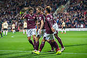 Steven MacLean (#18) of Heart of Midlothian FC celebrates with team mates after scoring a goal during the Betfred Scottish Football League Cup quarter final match between Heart of Midlothian FC and Aberdeen FC at Tynecastle Stadium, Edinburgh, Scotland on 25 September 2019.