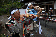 Sounding the horns (sea shels) at the house of Samurai Taisho of Minami Soma during Soma Nomaoi festival.