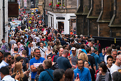 Edinburgh, Scotland, UK; 5 August, 2018. Edinburgh Fringe Festival's first weekend sees thousands of tourists and locals on the Royal Mile  enjoying the free street performers. Pictured;