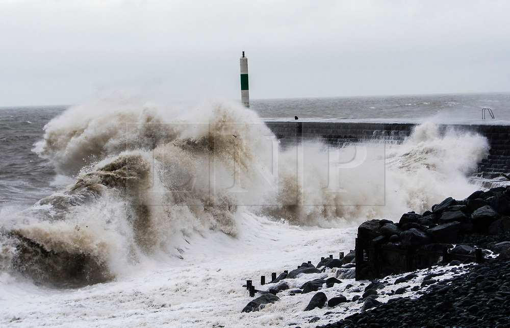 © Licensed to London News Pictures. 08/02/2019. Aberystwyth, UK.  Gale force south-westerly winds bring huge waves to batter the sea defences at Aberystwyth on the Cardigan Bay coast, West Wales at high tide as Stormy Erik hits the UK. Photo credit: Keith Morris/LNP
