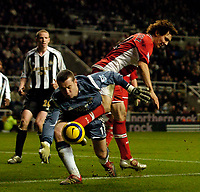 Photo: Jed Wee.<br />Newcastle United v Middlesbrough. The Barclays Premiership. 02/01/2006.<br />Middlesbrough's Emanuel Pogatetz (R) flails a leg into Newcastle goalkeeper Shay Given's midsection as he chases for the ball.