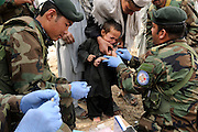 "ANA soldiers from 3rd Brigade, 201st Corps, provide free medical care to villagers during an operation in Tagab Valley.....Colonel Haynes said the battle plan, ""The creeping barrage of goodness,"" to win the hearts and minds of the Tagab Valley includes: a paved road, wells, radio stations, solar power, humanitarian aid, and medical outreach.  Agricultural development teaching how to package goods, and pruning techniques to increase crop yields.  Saffron cultivation started too, as a replacement to poppy.  More projects like schools and police checkpoints will follow as resources allow..."