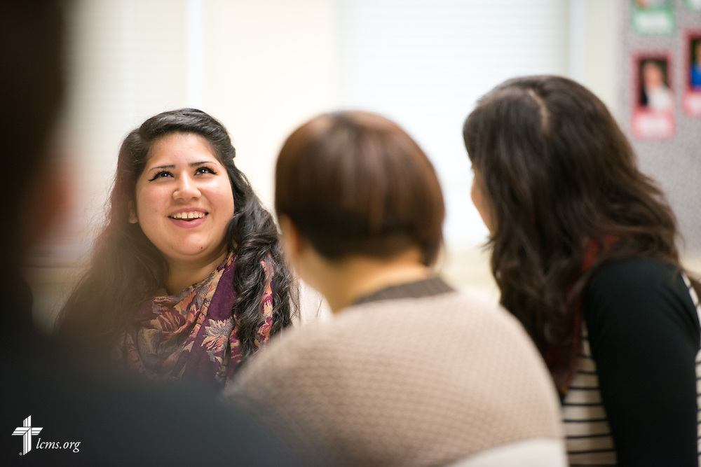 Gabriela Escobedo carries a discussion with fellow students during class in the Christopher Center on the campus of Concordia University Chicago in River Forest, Ill., on Friday, Oct. 10, 2014. LCMS Communications/Erik M. Lunsford