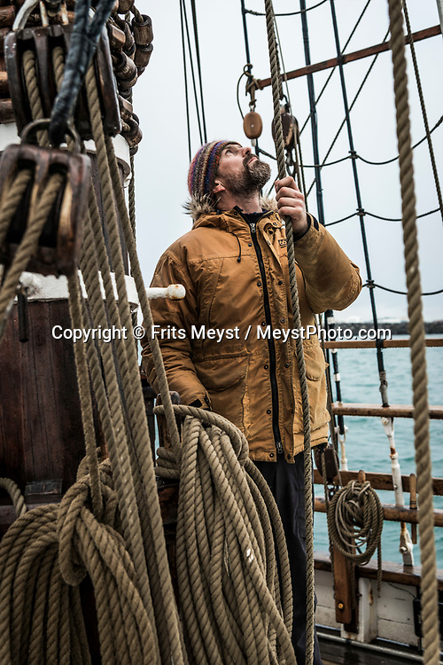 Iceland, April 2019. Captain Heimir Hardarson. Sail handling is part of the daily routine aboard Schooner Opal. Scientists, storytellers and industrial designers work together during the Ocean Missions Iceland scientific sailing expedition aboard Schooner Opal.  The organisation wants to inspire people to take direct action towards ocean conservation, by combining science and education with exploration and adventure. Photo by Frits Meyst / Meystphoto.com