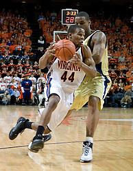 Virginia Cavaliers point guard Sean Singletary (44) dribbles against GT.  The Virginia Cavaliers Men's Basketball Team defeated the Georgia Tech Yellow Jackets 75-69 at the John Paul Jones Arena in Charlottesville, VA on February 24, 2007.