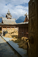 Hindu Temple in the small village of Kalpa, with wheat drying in the sun