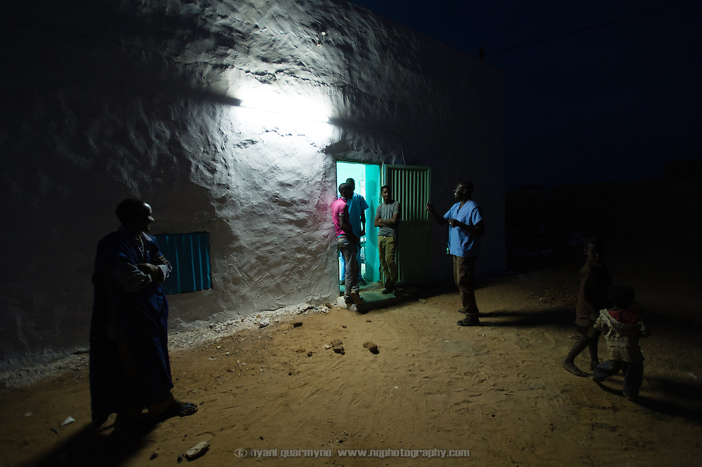 Surgeon, Thotho Kalombo, joking with hospital orderlies outside an observation ward at the recently completed Médecins Sans Frontières (MSF) surgical unit in Bassikounou, Mauritania on 2 March 2013. Now that the surgical unit is operational, surgical emergencies no longer have to be referred to the nearest government hospital, which is six hours away.
