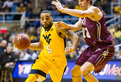 Dec 21, 2015; Morgantown, WV, USA; West Virginia Mountaineers guard Jaysean Paige (5) drives down the lane during the first half against the Eastern Kentucky Colonels at the WVU Coliseum. Mandatory Credit: Ben Queen-USA TODAY Sports