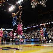 Monica Wright, (left), Minnesota Lynx, drives to the basket defended by Alex Bentley, Connecticut Sun, during the Connecticut Sun Vs Minnesota Lynx, WNBA regular season game at Mohegan Sun Arena, Uncasville, Connecticut, USA. 27th July 2014. Photo Tim Clayton