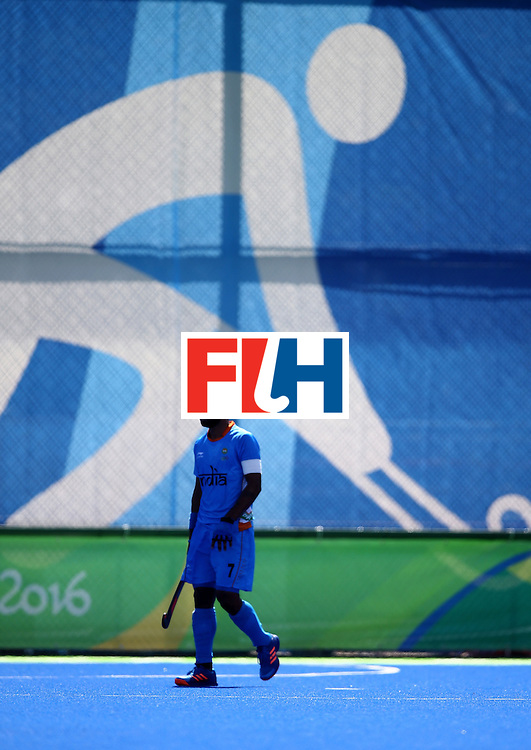 RIO DE JANEIRO, BRAZIL - AUGUST 11:  Manpreet Singh #7 of India walks off the field afer a game against Netherlands during a Men's Preliminary Pool B match on Day 6 of the Rio 2016 Olympics at the Olympic Hockey Centre on August 11, 2016 in Rio de Janeiro, Brazil.  (Photo by Sean M. Haffey/Getty Images)