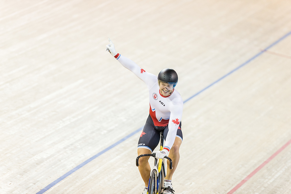 Hugo Barette of Canada celebrates his team's gold medal win over Venezuela in the men's team sprint at the 2015 Pan American Games in Toronto, Canada, July 16,  2015.  AFP PHOTO/GEOFF ROBINS