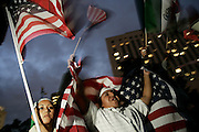 Lorena Pacanins, left, and Luis Rosas protest at the National Day of Action demonstration in Los Angeles, CA on Monday, April 10, 2006.<br />