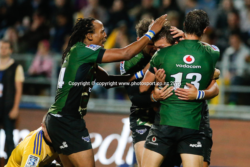 Bull's Handre Pollard is congratulated on his try during the Super Rugby match, Hurricanes v Bulls, McLean Park, Napier, New Zealand. Saturday, 05 April, 2014. Photo: John Cowpland / photosport.co.nz