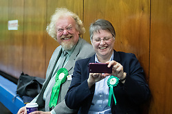 © Licensed to London News Pictures . 12/12/2019. Bury, UK. Green Party candidate in Bury South GLYN HEATH (l) at the count for seats in the constituencies of Bury North and Bury South in the 2019 UK General Election , at Castle Leisure Centre in Bury . Photo credit: Joel Goodman/LNP