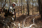 April 9, 2011, Camp Edwards, MA - Cadet Jon Broderick patrols through the woods during a field training exercise. Broderick plans to train at Fort Bragg in Fayetteville, NC this summer. Photo by Lathan Goumas