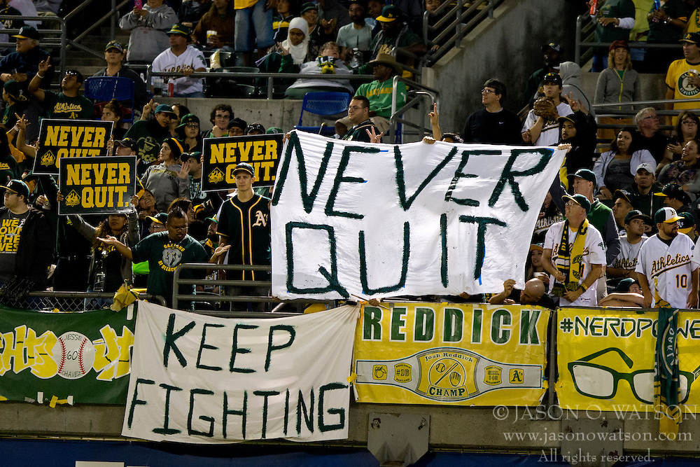 OAKLAND, CA - SEPTEMBER 23:  Oakland Athletics fans hold up signs encouraging their team during the seventh inning against the Los Angeles Angels of Anaheim at O.co Coliseum on September 23, 2014 in Oakland, California. The Los Angeles Angels of Anaheim defeated the Oakland Athletics 2-0.  (Photo by Jason O. Watson/Getty Images) *** Local Caption ***