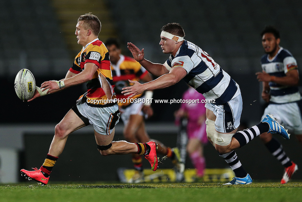 Damian McKenzie of Waikato is chased by Blake Gibson of Auckland. ITM Cup rugby union match, Auckland v Waikato at Eden Park, Auckland, New Zealand. Thursday 2 October 2014. Photo: Anthony Au-Yeung / www.photosport.co.nz