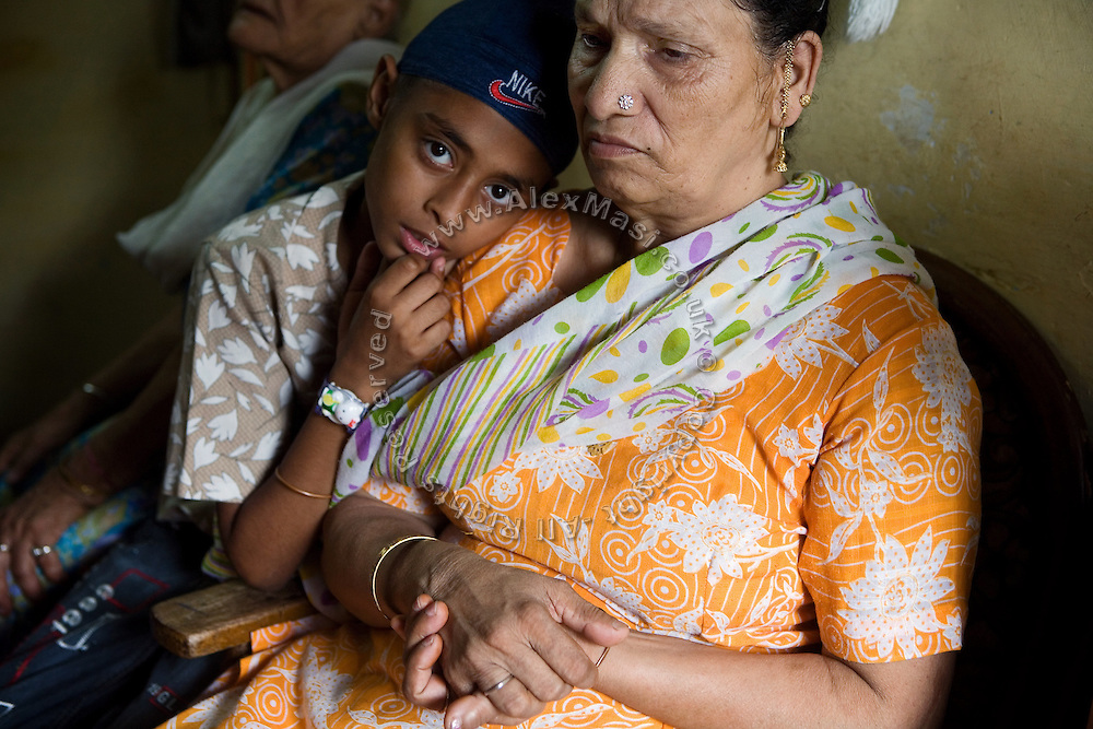 .Harjinder Kaur, 57, (right) is sitting in her home in Tilak Vihar, New Delhi, India. She has lost her husband and other members of her family during the anti-Sikh riots erupted in New Delhi in 1984 in the light of Indira Gandhi's assassination by her Sikh bodyguards.