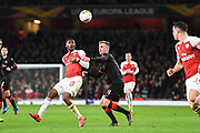 Rennes Benjamin Bourigeaud (14) and Arsenal Midfielder Ainsley Maitland-Niles (15) in action during the Europa League round of 16, leg 2 of 2 match between Arsenal and Rennes at the Emirates Stadium, London, England on 14 March 2019.
