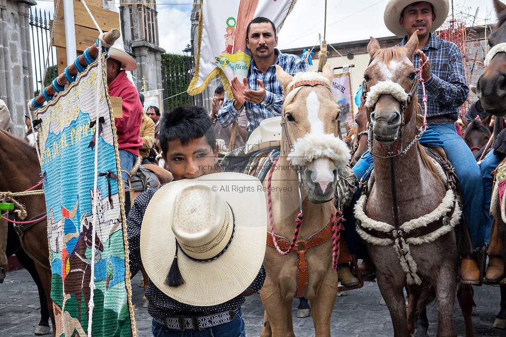 Mexican cowboys gather on horseback for Catholic Mass in the Jardin Allende at the end of their pilgrimage celebrating the festival of Saint Michael in San Miguel de Allende, Mexico.