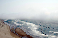 Panoramic view of surf and cloud along the central Oregon coast