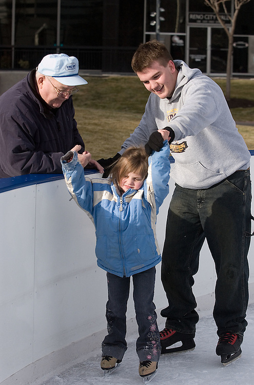 Neighborhoods Reno-Center..Brandon Block (cq), 18, and Sydney Eldridge (cq), 5, of Fernley, Nev., skate at the ice rink in Downtown Reno, Tuesday, Jan. 2, 2007, while their grandfather Clarence Anderson (cq), 69, from South Dakota watches...Photo by David Calvert/Reno Gazette-Journal