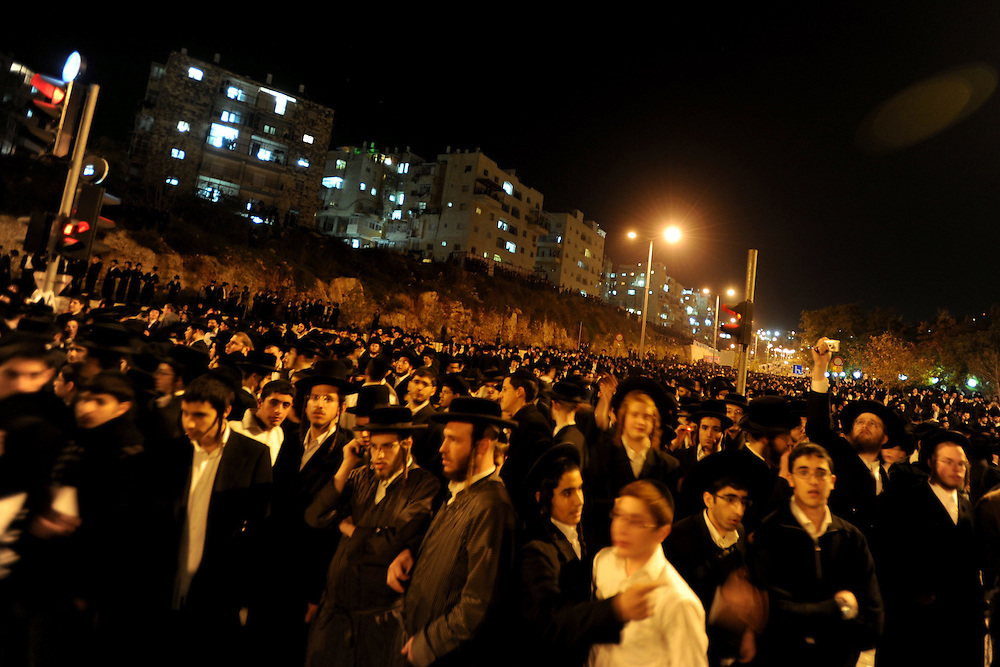 Thousands of Ultra-Orthodox Jewish men are demonstrating near Intel Corp's electronic chip plant in Jerusalem December 27, 2009. Thousands of Ultra-orthodox Jews demonstrated on against the operation of the plant on the Jewish Sabbath.