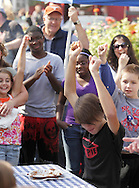 New Hampton, New York - The winner of a pie-eating contest reacts during the celebration of 100 years in business at Soons Orchards and Farm Market on Oct. 11, 2010.