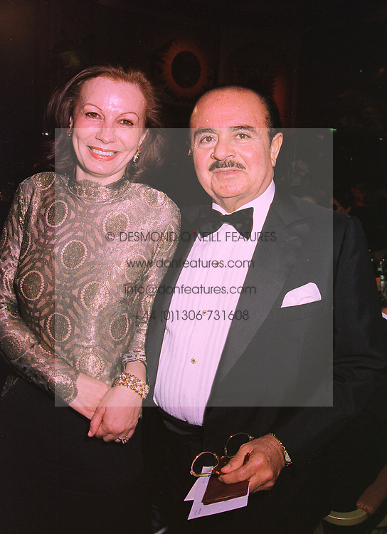 MRS ELIZABETH TSAKIROGLOU and MR ADNAN KHASHOGGI the multi millionaire middle eastern businessman, at a ball in London on 19th November 1997.MDL 8