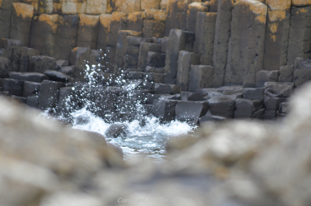 The waves and spray against the Giant's Causeway.  County Antrim, Northern Ireland.
