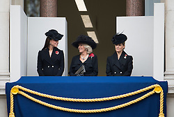 © London News Pictures. 09/11/2014. London, UK. L to R Catherine Duchess of Cambridge, Camilla Duchess of Cornwall and Sophie Duchess of Wessex,  looking over during the Remembrance Ceremony at the Cenotaph war memorial in London, United Kingdom, on November 09, 2014. Royalty and Politicians joined the rest of the county in honouring the war dead by gathering at the iconic memorial to lay wreaths and observe two minutes silence. Photo Credit: Ben Cawthra/LNP