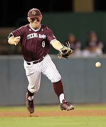 Texas A&M's Boomer White (8) miss handles a hard ground ball against TCU during the 7th inning of a NCAA college baseball super regional tournament game, Friday, June 10, 2016, in College Station, Texas. (AP Photo/Sam Craft)