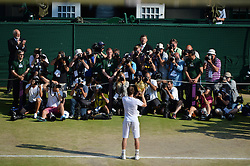 © London News Pictures. 07/07/2013 . London, UK. Andy Murray holding the trophy in front of photographers as he celebrates winning the men's singles final over Novak Djokovic of Serbia at the Wimbledon Lawn Tennis Championships, becoming the first British male to win the tournament in 77 years. Photo credit: Mike King/LNP