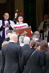 © Licensed to London News Pictures . 30/08/2012 . Manchester, UK . The funeral of Winnie Johnson . Moors Murderer Ian Brady and Myra Hindley murdered Johnson 's 12 year old son Keith Bennett . Winnie Johnson dedicated her life to finding her son's body . Photo credit : Joel Goodman/LNP