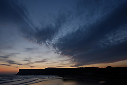 © Licensed to London News Pictures. <br /> 08/10/2014. <br /> <br /> Saltburn, United Kingdom<br /> <br /> Dawn breaks over Huntcliff in Saltburn by the Sea in Cleveland.<br /> <br /> Photo credit : Ian Forsyth/LNP