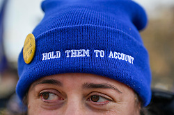 © Licensed to London News Pictures. 29/01/2020. LONDON, UK.  An Anti-Brexit protester in Parliament Square wears a beanie with the words Hold Them To Account.  Anti-Brexit protesters are calling on holding the Boris Johnson, Prime Minister, and his government to account during the upcoming Brexit negotiations.  Britain will formerly leave the European Union at 11pm on 31 January.  Photo credit: Stephen Chung/LNP