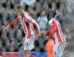 Stoke's Peter Crouch celebrates his goal with Stoke's Mame Biram Diouf - Photo mandatory by-line: Dougie Allward/JMP - Mobile: 07966 386802 - 06/12/2014 - SPORT - Football - Stoke - Britannia Stadium - Stoke City v Arsenal - Barclays Premie League