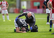 12th August 2017, SuperSeal Stadium, Hamilton, Scotland; SL Football league Hamilton Academicals versus Dundee; Dundee's Randy Wolters in pain after injury as physio Gerry Docherty checks him out