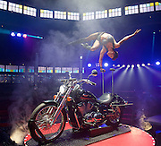 La Soiree<br /> at the La Soiree Spiegeltent, Southbank Centre, London, Great Britain <br /> press photocall<br /> 29th October 2015 <br /> <br /> <br /> Melanie Chy<br /> balance &amp; strength act on a motorcycle<br /> <br /> <br /> <br /> Photograph by Elliott Franks <br /> Image licensed to Elliott Franks Photography Services