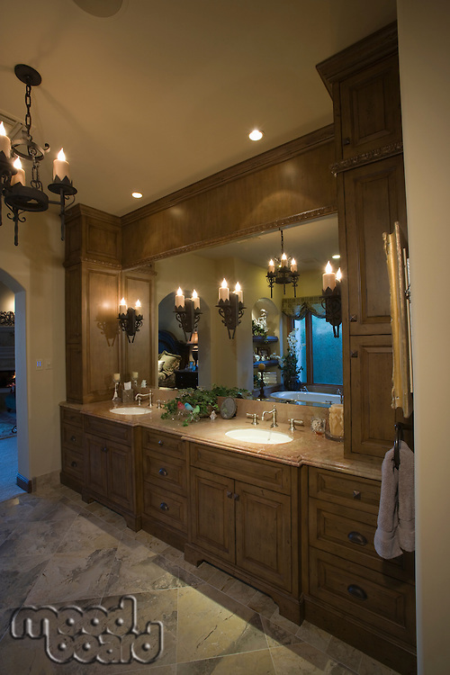 Palm Springs bathroom with lit chandelier