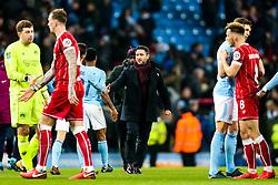 Bristol City Head Coach Lee Johnson congratulates Bernardo Silva of Manchester City after Manchester City win 2-1 in added time - Rogan/JMP - 09/01/2018 - Etihad Stadium - Manchester, England - Manchester City v Bristol City - Carabao Cup Semi Final First Leg.