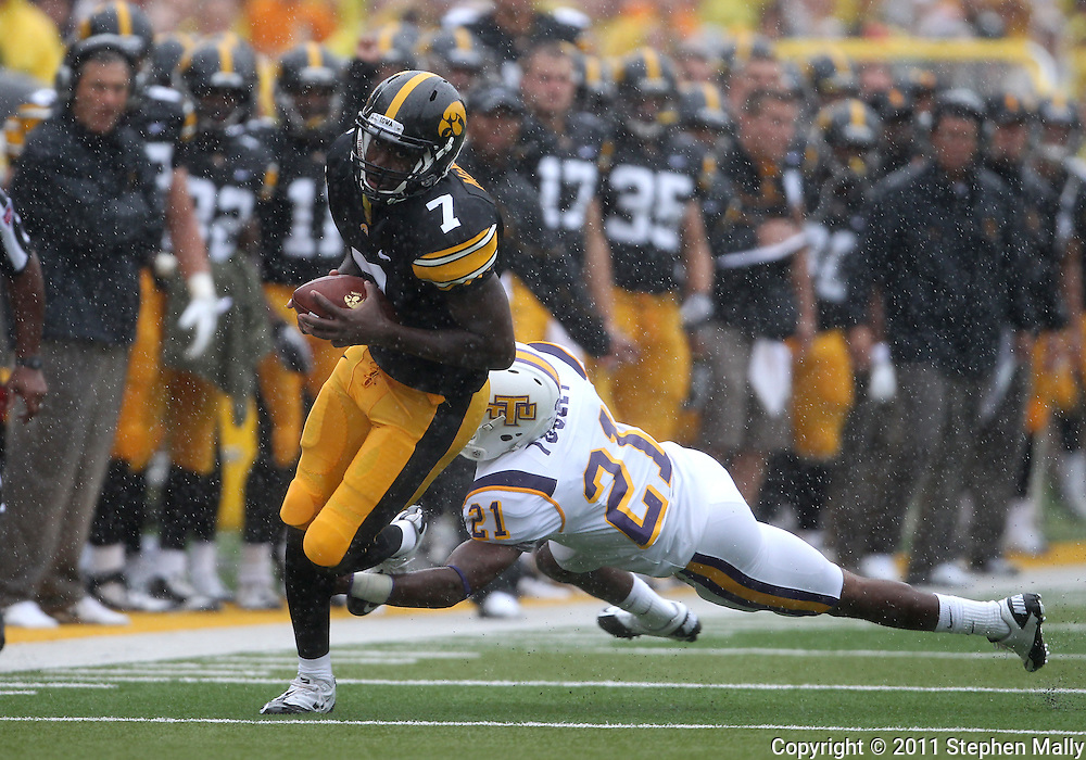 September 3, 2011: Iowa Hawkeyes wide receiver Marvin McNutt (7) runs out of a tackle by Tennessee Tech Golden Eagles cornerback Richmond Tooley (21) during the first half of the game between the Tennessee Tech Golden Eagles and the Iowa Hawkeyes at Kinnick Stadium in Iowa City, Iowa on Saturday, September 3, 2011. Iowa defeated Tennessee Tech 34-7 in a game stopped at one point due to lightning and rain.