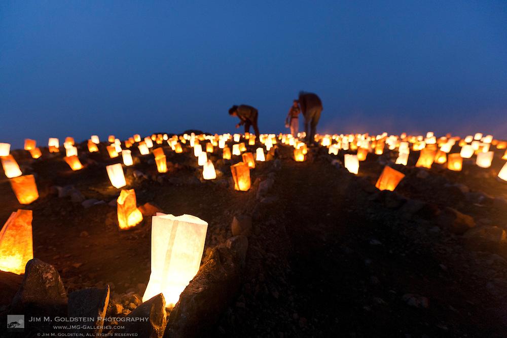 Close up of volunteers lighting luminaries at the Lands End Labyrinth - San Francisco, California