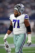 Dallas Cowboys offensive tackle La'el Collins (71) walks back to the sideline carrying a towel during the 2017 NFL week 3 preseason football game against the Oakland Raiders, Saturday, Aug. 26, 2017 in Arlington, Tex. The Cowboys won the game 24-20. (©Paul Anthony Spinelli)