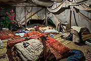 Palestinian children sleep inside their family tent in Susiya. It is one of the structures under demolition order.