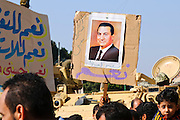A poster of Hosni Mubarak at a pro-Mubarak rally in downtown Cairo, part of a counter demonstration to the anti-government rally in Tahrir Square. (Cairo, Egypt - February 2, 2011).