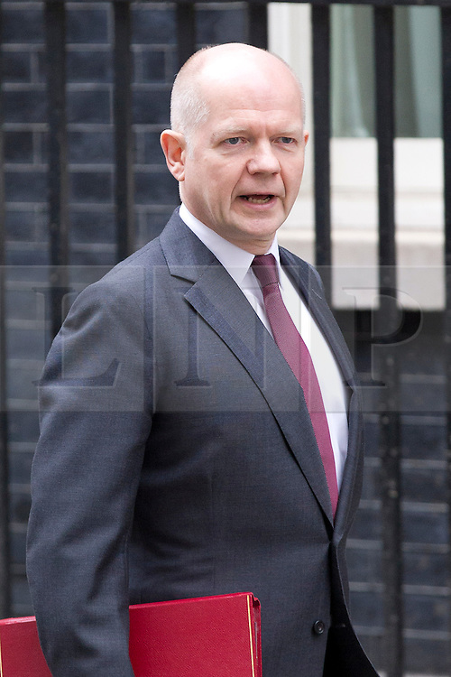 © Licensed to London News Pictures. 18/03/2014. London, UK. The Foreign Secretary, William Hague, arrives for a meeting of the British cabinet on Downing Street in London today (18/03/2014). Photo credit: Matt Cetti-Roberts/LNP