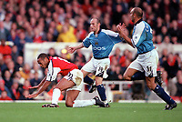 Thierry Henry (Arsenal) is tripped by Manchester City defender Danny Tiatto (who is then sent off for his 2nd yellow card). Arsenal v Manchester City, F.A.Carling Premiership, 28/10/2000. Credit Colorsport / Stuart MacFarlane.