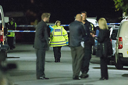 © Licensed to London News Pictures . 12/10/2015 . Eccles , UK . Police on the scene on Gillingham Road , Eccles where it's reported a woman and a child were both shot this evening (12th October 2015) . It's reported the victims are a woman and her young son who were shot in the legs . It's the fifth shooting in Manchester in under a week . Photo credit : Joel Goodman/LNP