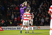 Stoke City forward Jonathan Walters beats Doncaster Rovers goalkeeper Thorsten Stuckmann in the air during the The FA Cup third round match between Doncaster Rovers and Stoke City at the Keepmoat Stadium, Doncaster, England on 9 January 2016. Photo by Simon Davies.